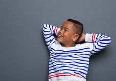 Boy smiling with hands behind head Stock Photography
