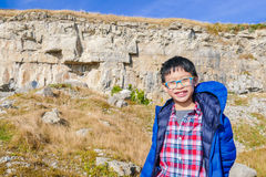 Boy smiling on hill Royalty Free Stock Images