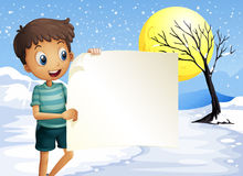 A boy smiling holding an empty signage Stock Photography