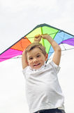 Boy smiling with kite Royalty Free Stock Image