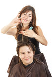 Boy smiling with long hair at happy female hairdresser Stock Photo