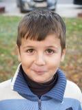 Boy smiling outdoors stock photos