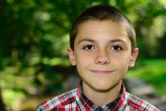 Boy Smiling Outdoors Plaid Shirt Royalty Free Stock Photography