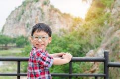 Boy smiling in park Stock Photos