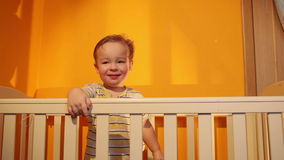 Boy smiling in playpen. stock video