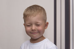 Boy smiling portrait with closed eyes Royalty Free Stock Photography