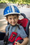 Boy smiling in the seat bicycle. Kid has biking helmet. Protection on the bicycle. Royalty Free Stock Photo