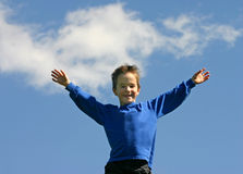 Boy Smiling in the Sky Stock Images