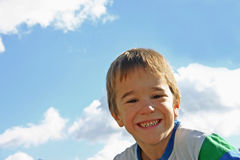 Boy Smiling in the Sky Royalty Free Stock Photos