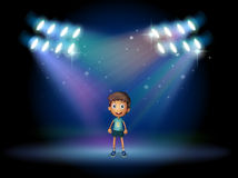 A boy smiling at the stage Stock Images