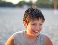 Boy smiling in the summer at the beach Stock Photography
