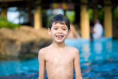 Boy smiling after a swim in the pool Royalty Free Stock Photo