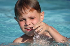 Boy smiling in swimming pool Royalty Free Stock Photo