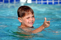 Boy smiling in swimming pool Royalty Free Stock Image