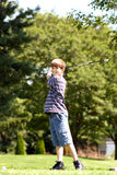 Boy Smiling Swinging Royalty Free Stock Photography