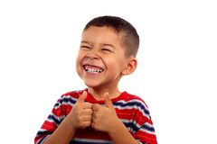Boy smiling with thumbs up. A young boy making a thumbs up sign and flashing a silly smile stock photography