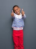 Boy smiling with thumbs up sign Royalty Free Stock Photo