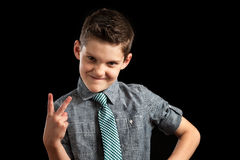 Boy Smirking and Making Peace Sign Royalty Free Stock Photo