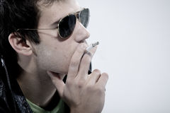 Boy smoking a cigarette Royalty Free Stock Images
