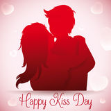 Boy Smooching with her Girlfriend in Kiss Day, Vector Illustration. In love couple kissing silhouette with floating hearts in background for Kiss Day Royalty Free Stock Photography