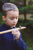 Boy and snail Stock Photography