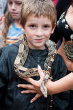 Boy with snake Stock Photo