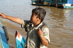 The boy with a snake. Tonle Sap Lake. Cambodia. Royalty Free Stock Photo