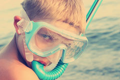 Boy with snorkel and goggles Stock Photos