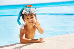 Boy with snorkel mask on head and pointing finger Stock Photography