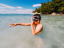 Boy snorkeler cleaning googles Stock Photography