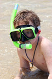 Boy snorkeling in Caribbean. Little boy on beach with snorkeling equipment Royalty Free Stock Photography