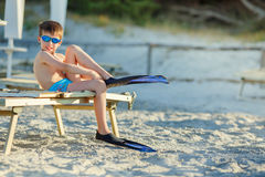 Boy with snorkeling equipment at tropical beach Royalty Free Stock Image