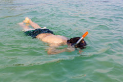 Boy snorkeling in the ocean Stock Photo