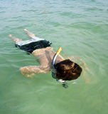 Boy snorkeling in the ocean Royalty Free Stock Images