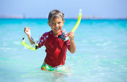 Boy snorkeling. Portrait of happy cute boy with snorkeling mask ready to dive in the sea stock photos