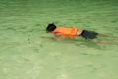 Boy snorkeling in the sea. Boy snorkeling in the island beach in Krabi, Thailand Royalty Free Stock Photos