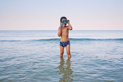 Boy snorkeling in sea Stock Images
