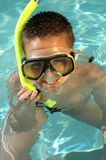 Boy snorkeling in swimming pool. Boy snorkeling and having fun on a hot summer day Stock Photo
