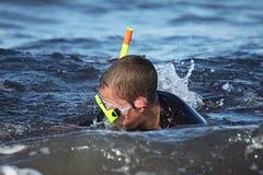 Boy snorkelling for seashells Stock Image
