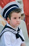 Boy with snot in his nose dressed in navy costume. Little sailor.Boy with snot in his nose dressed in navy costume Royalty Free Stock Images