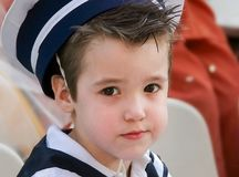 Boy with snot in his nose dressed in navy costume. Little sailor.Boy with snot in his nose dressed in navy costume Stock Image