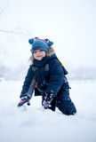 Boy in the snow. Winter, always happy to play in the snow and cold are not afraid Stock Photos