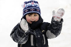 Boy in the snow. Boy playing in the winter snows Stock Photography