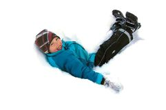 Boy in snow. Young boy laying in snow Stock Photography