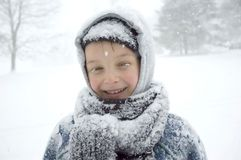 Boy on the Snow. Boy with snow on his eyelashes royalty free stock images