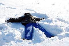 Boy in the snow. Royalty Free Stock Photo