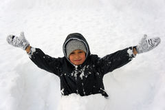 Boy in snow Stock Photos
