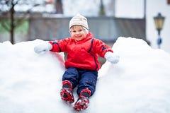 Boy On Snow. Smiling Boy On Snow sliding Stock Photo