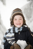 Boy with snow Royalty Free Stock Image