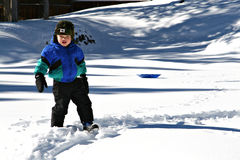 Boy in the Snow. Toddler walking in the snow Royalty Free Stock Photo
